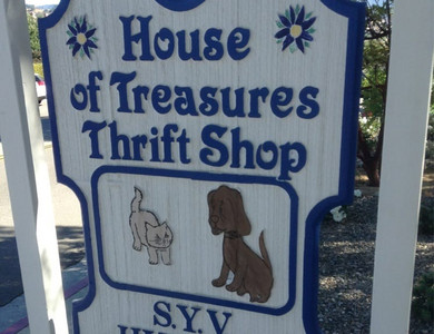House of treasures thrift shop sign